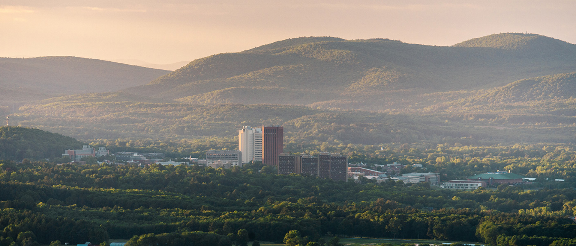 Distant view of UMass with mountains in the background